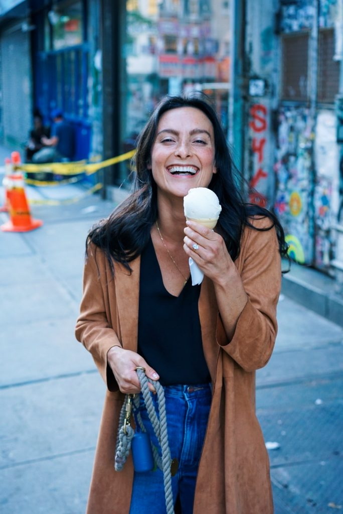 woman-wearing-brown-trench-coat-while-holding-ice-cream-2448531